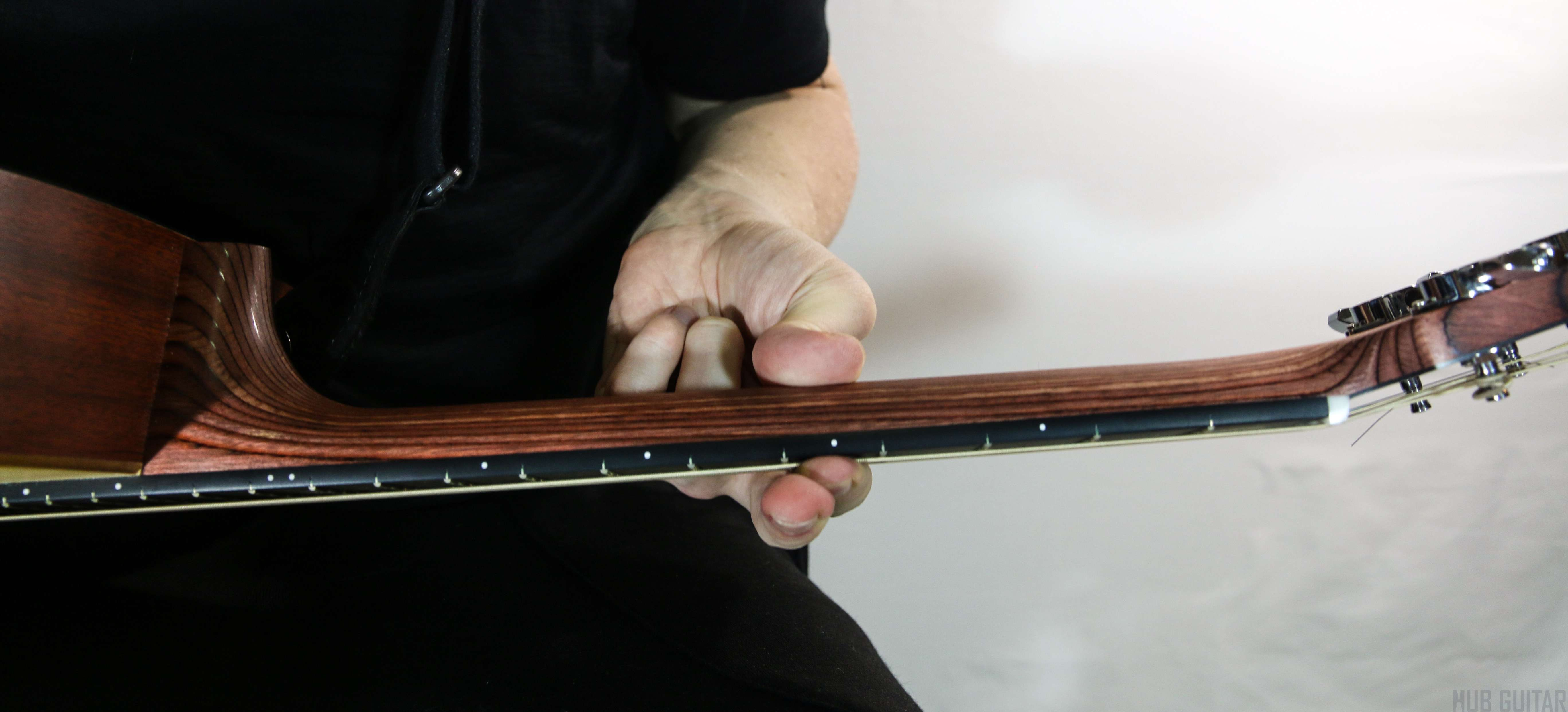 Using the thumb to support the barre chord.